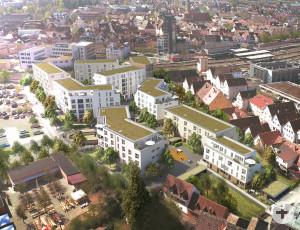 Oberbürgermeister Matthias Klopfer (3.v.r.) übergibt die Baugenehmigung an Bianca Reinhardt Weith.